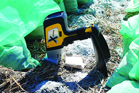 DELTA XRF Handheld Analyzer, testing rock out in the field