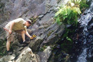 Geologist in the field with a Handheld DELTA XRF