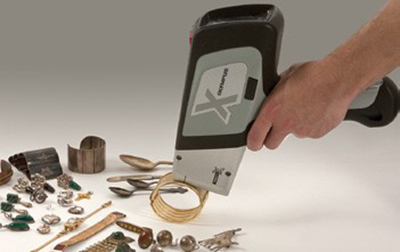 Handheld DELTA XRF Analyzer testing jewellery